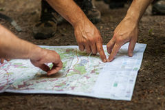 Navigating with map and compass Stock Photo