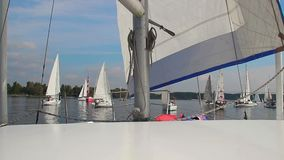 Navigating a racing yacht POV, racers line up for regatta. Stock footage stock video footage