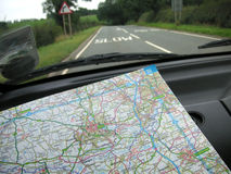 Navigating the roads. Using a road map Stock Image