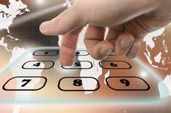 Navigating virtual telephone keyboard. Detail of male hand navigating virtual telephone keyboard Stock Photo
