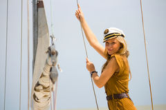 Navigation. A young girl on the deck yacht Royalty Free Stock Photos