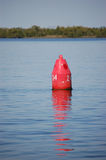 Navigation aid Red Nun. A red nun sits in the Peace River warning boaters of the channel boundaries stock photo