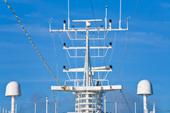 Navigation antenna of cruise liner. With blue sky on background Royalty Free Stock Photos
