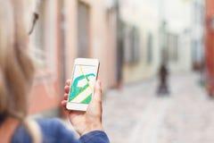 Navigation app on the mobile phone. Tourist using navigation app on the mobile phone Stock Images
