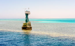Navigation beacon for ships on a sand bank Royalty Free Stock Image