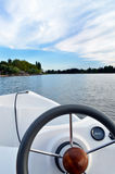Navigation with boat. Navigation on board an electric boat on a lake royalty free stock photos
