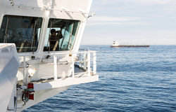 Navigation bridge of oil tanker with watch officer Royalty Free Stock Image