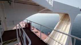 Navigation bridge wing, superstructure, deck of large crude oil carrier, sea. Starboard. stock footage