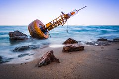 Navigation buoy Aground on the beach.  Stock Photos