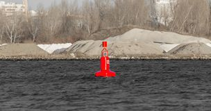 Navigation buoy from the river channel at the mouth of the river. Navigation buoy on the fairway of the river indicates the path. For the passage of ships stock images