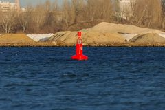 Navigation buoy from the river channel at the mouth of the river. Navigation buoy on the fairway of the river indicates the path. For the passage of ships stock photo