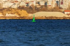 Navigation buoy from the river channel at the mouth of the river. Navigation buoy on the fairway of the river indicates the path. For the passage of ships stock image