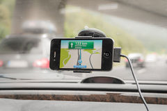 Navigation in car. Using smart phone navigation system in car Stock Photo
