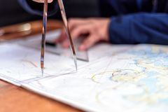 Navigation in the chart room on a sailing yacht. Navigation with sea charts in the chart room on a sailing yacht Stock Photo