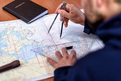 Navigation in the chart room on a sailing yacht. Navigation with sea charts in the chart room on a sailing yacht royalty free stock images