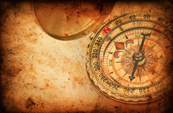 Navigation compass on Grunge old paper texture Royalty Free Stock Image