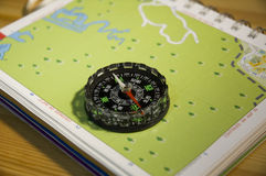 Navigation Compass and Map. A compass on a map for navigation Royalty Free Stock Photography