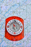 Navigation: compass and a map. Stock Image
