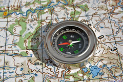 Navigation: compass and a map. Royalty Free Stock Image