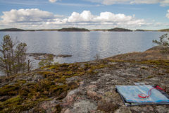 Navigation with compass and a map. View on islands in Stockholm Archipelago with a map and compass stock photos