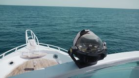 A navigation compass on a yacht in the open ocean. Against the background of the blue sea. The concept of business or. Life management, vacation or tourism stock video footage
