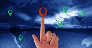 Navigation Concept Background. Navigation concept, male hand holding red pin, green pin on world map background, Elements of this image furnished by NASA Stock Photo