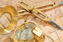 Navigation device on a background an old map royalty free stock image