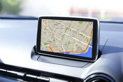 Navigation device in the car. Navigation device panel in the modern car stock image