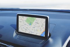 Navigation device in the car. Navigation device panel in the modern car stock photo