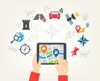 Navigation Icons Background. Human hands holding a tablet and checking a map with navigation icons or a mobile app Stock Photography