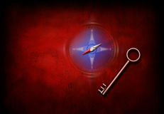Navigation Key. Key on grunge red with blue compass stock photo