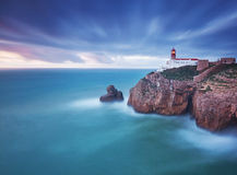 Navigation lighthouse on the ocean. Royalty Free Stock Image