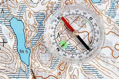 Navigation with map. Navigation with topographic map and regular compass Stock Images