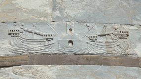 Navigation in the Middle Ages. Navigation and maritime trade in the Middle Ages. Two ships with sailors enter the Port of Pisa Old Maritime Republic with royalty free stock image
