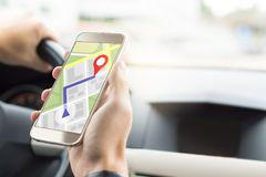 Navigation with mobile app in smartphone. Stock Images
