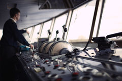 Navigation officer driving ship on the river. Stock Image