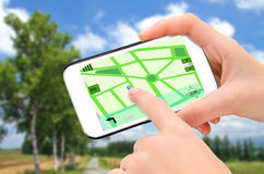 Navigation in phone. Tourist using navigation app on the mobile phone Stock Images