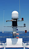 Navigation radar and lights on the bow of a ferry Royalty Free Stock Images