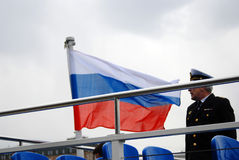 Navigation season opening in Moscow. Boat captain and Russian state flag tricolor Stock Photo