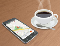 Navigation. Smart phone with navigation and cup of coffee Royalty Free Stock Photo