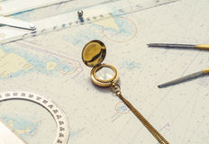 Navigation still-life. Skipper equipment and a map. Stock Images