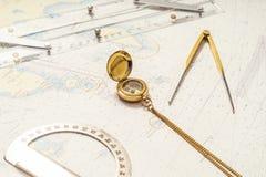 Navigation still-life. Skipper equipment and a map. Stock Photo