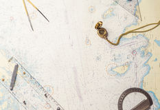 Navigation still-life - skippers equipment and a map Royalty Free Stock Photography