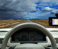 Navigation system . car on the road among fields Stock Images