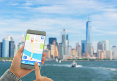 Navigation system or GPS smartphone. Using the navigation system or GPS smartphone mobile phone to navigate to your destination Royalty Free Stock Image