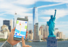 Navigation system or GPS smartphone. Using the navigation system or GPS smartphone mobile phone to navigate to your destination Royalty Free Stock Images