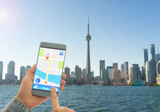 Navigation system or GPS smartphone. Using the navigation system or GPS smartphone mobile phone to navigate to your destination Stock Photos