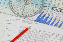 Navigation - Tide Tables. Tide tables and navigation instruments denoting passage planning stock image