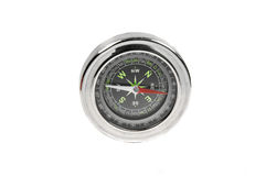 Navigational Compass. Metalic compass used for navigation having multiple levels. Metalic and shiny equipment stock photo