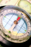 Navigational Compass on Topographical Map Stock Images